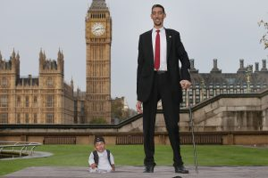 LONDON, ENGLAND - NOVEMBER 13:  The shortest man ever, Chandra Bahadur Dangi meets the worlds tallest man, Sultan Kosen for the very first time on November 13, 2014 in London, England. Chandra from Nepal measuring 54.6 cm (21.5 inches) posed for photographers with Sultan from Turkey who is 251 cm (8 ft 3 inches). Today is the 10th annual Guinness World Records Day during which thousands of people are expected to come together to celebrate the international day of record-breaking!  (Photo by Peter Macdiarmid/Getty Images)
